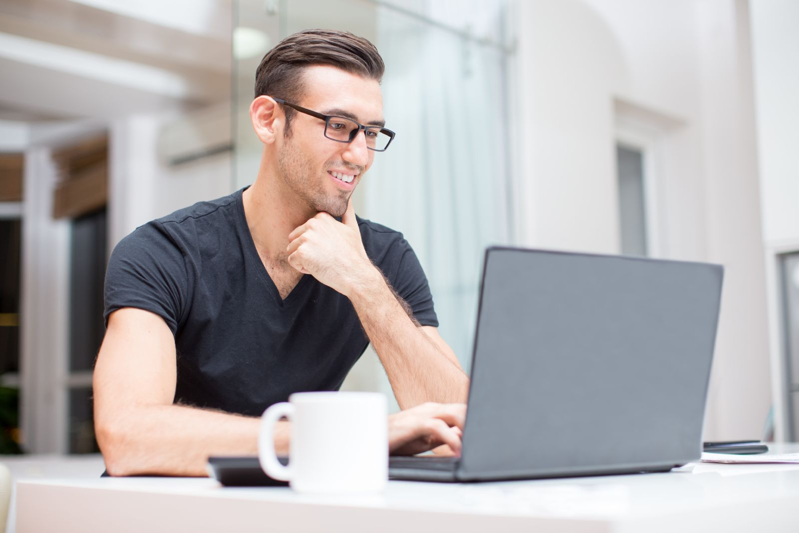 man-laptop-glasses-room-office-young-guy-happy-velox-clearing-pexels