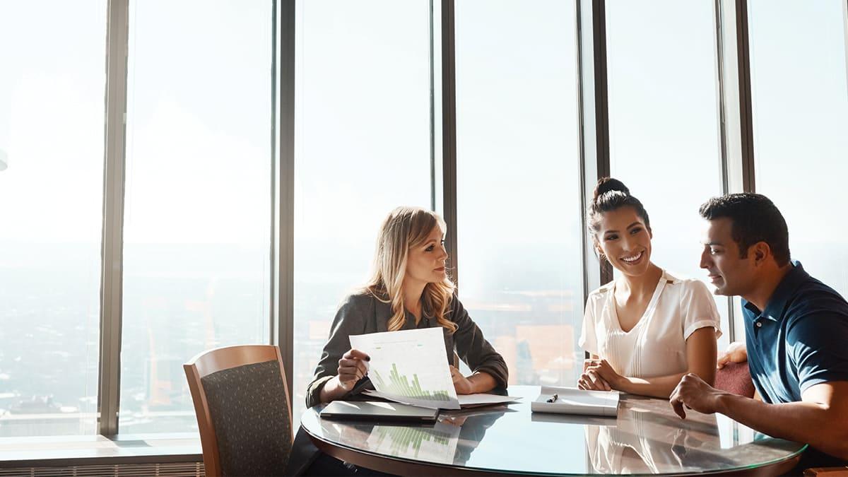 advisor-helping-couple-money-finance-office-robo-velox-clearing
